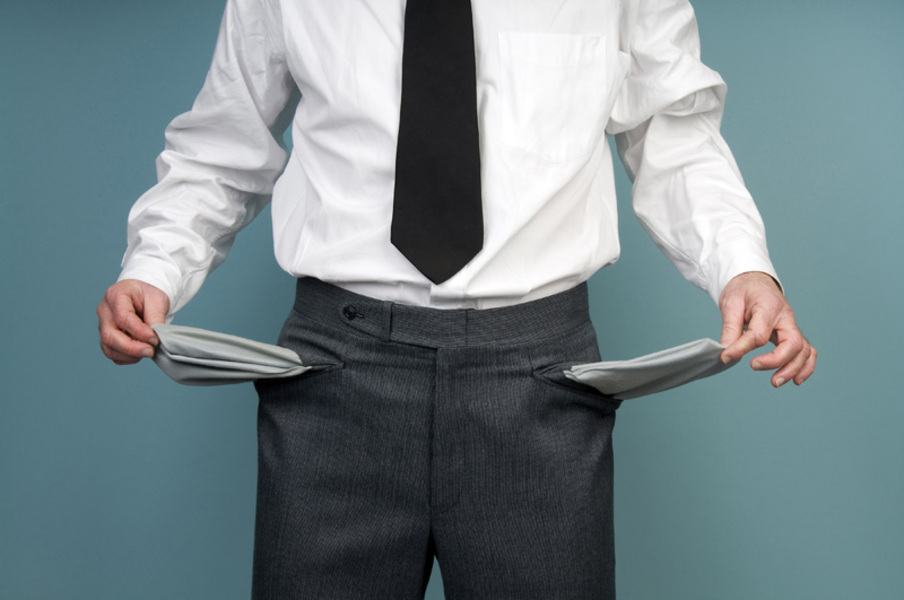 Businessman holding empty pockets