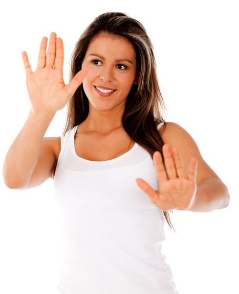 Woman playing with her hands moving imaginary objects - isolated