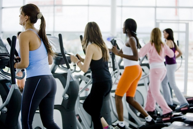 group of women at the gym doing exercise on the xtrainer machines