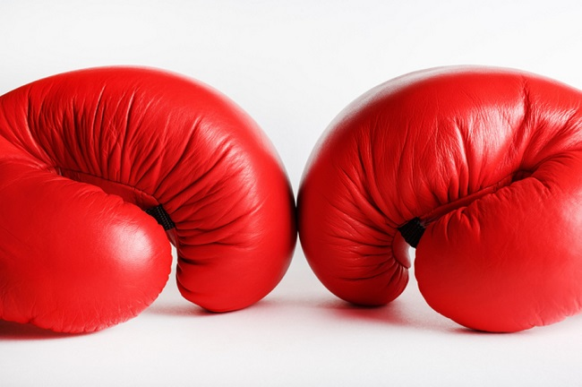 A pair of red boxing gloves. Sports concept.